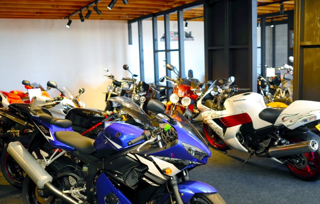 Shore Motor Cycles Interior showing a large range of motorcycles lined up